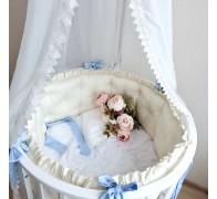 """Цельные бортики """"Pure"""" на овальную кроватку с оборкой (рюшей) и пуговками, обшитыми тканью в цвет комплекта."""